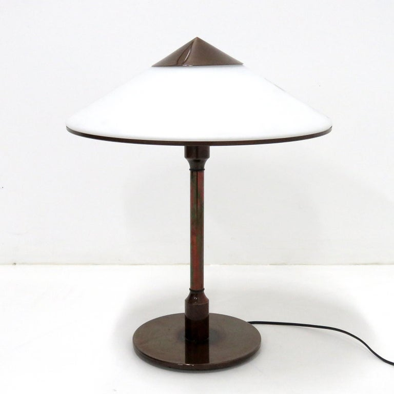 Elegant table lamp 'Kongelys' designed in 1937 by Niels Rasmussen Thykier for Fog & Mørup, bronze colored brass base and shade cap/trim with a white glass shade, individual on/off switch on the top of the stem, limited edition produced by Horn