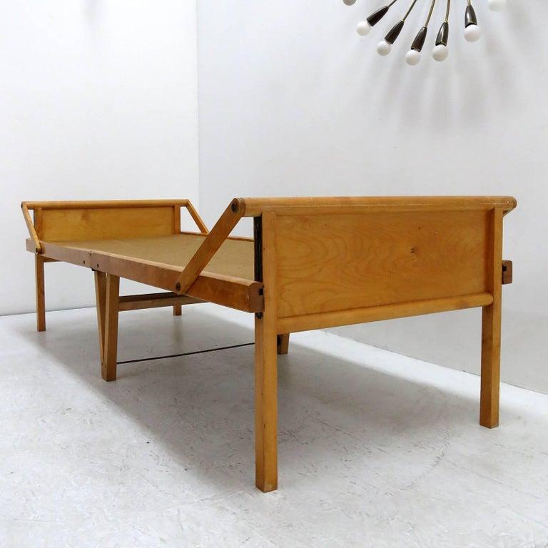 wonderful folding bed by Brdr. Johansson Sweden, in solid birch with canvas, marked Brdr. Johansson & Co., Turistsängen 'Tor', Smålandsstenar, Patent 36528,.