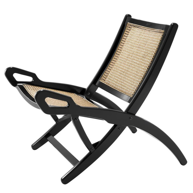 Folding cane rattan and blackened mahogany folding lounge chair, modern revival of a colonial lounge design.