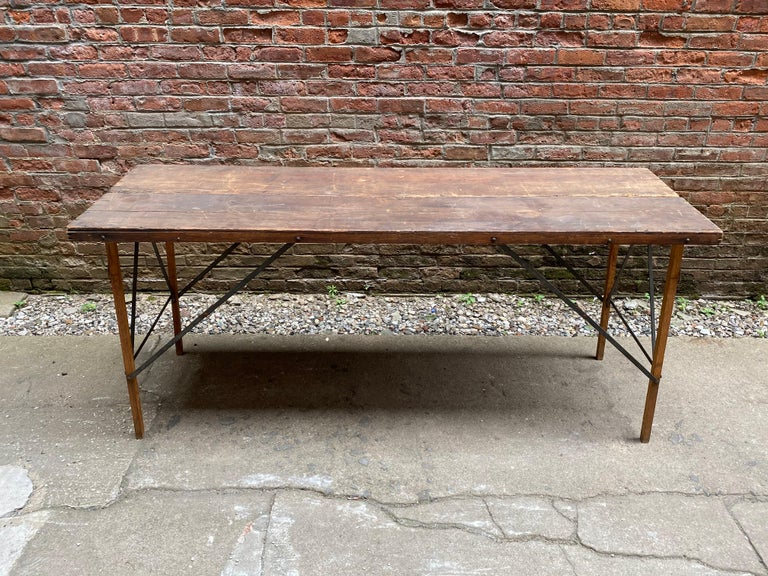 Compact and lightweight vintage wallpaper hanger's table. The legs extend and the top flips open for ultimate flat work space. Great as a console or display. All wood construction, circa 1920-1930. Wear commensurate with age and use. There is a