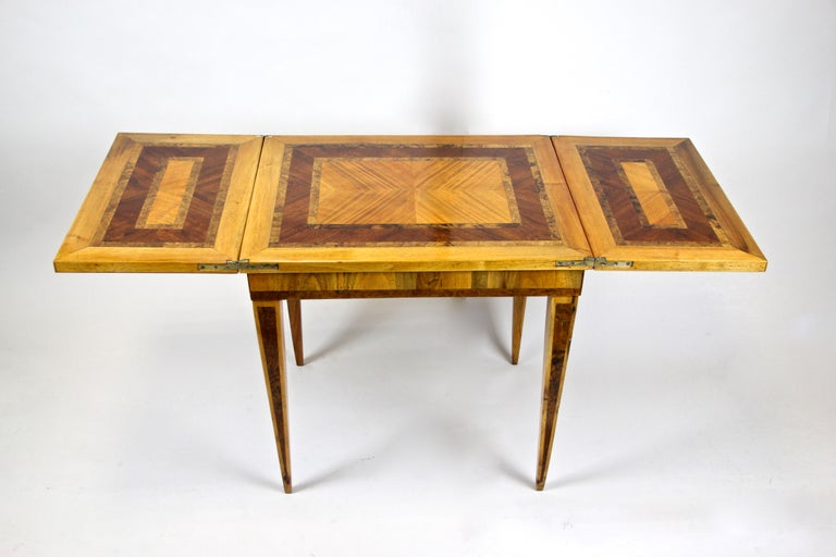 Truly elegant late 18th century folding side table from the so-called