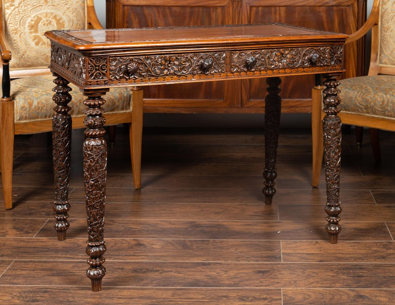 20th Century Foliage Carved 1900s Anglo-Indian Table with Two Drawers and Turned Legs For Sale