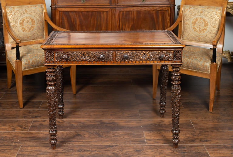 Oak Foliage Carved 1900s Anglo-Indian Table with Two Drawers and Turned Legs For Sale