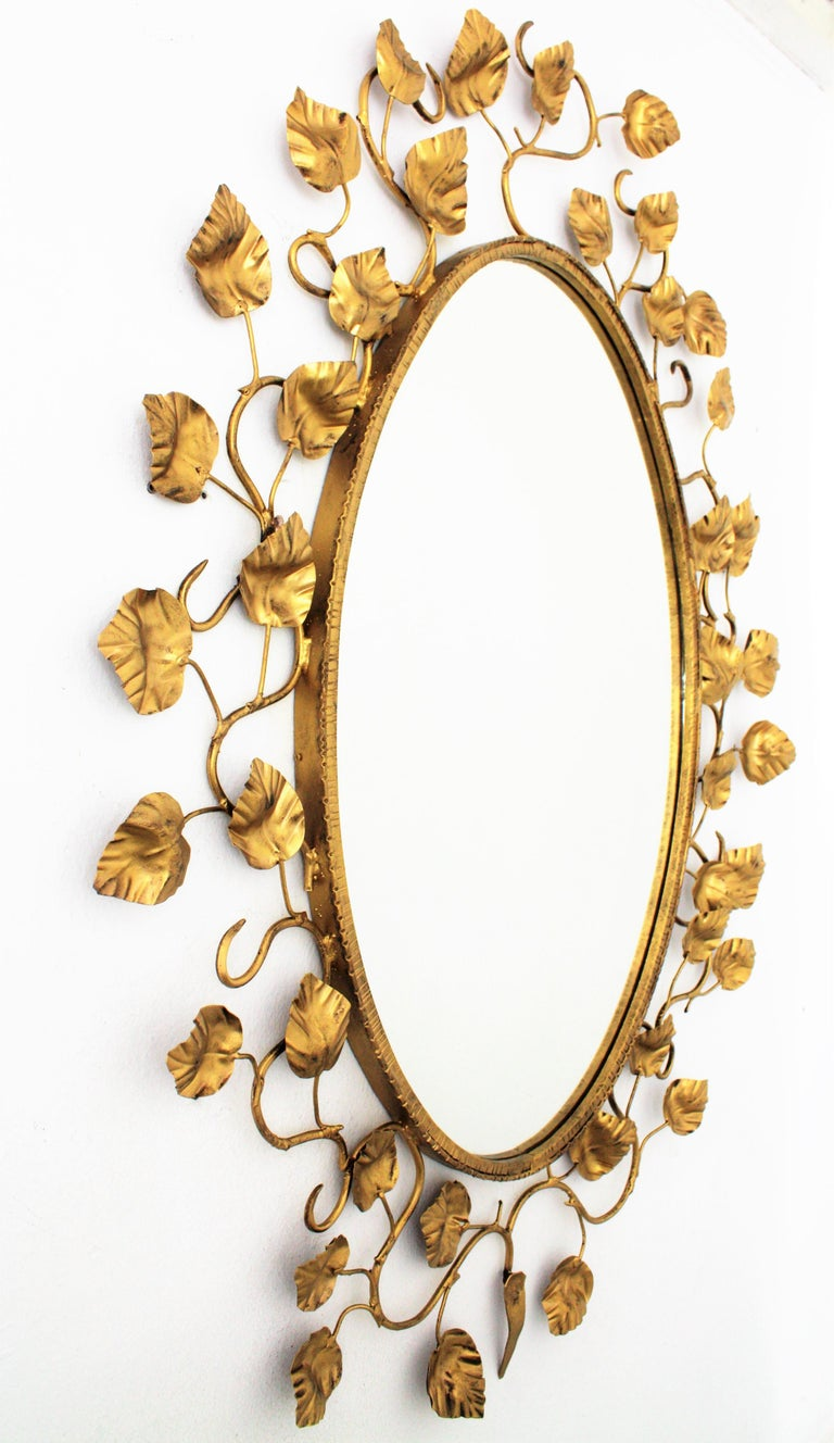 Hollywood Regency Foliage Oval Mirror in Gilt Metal For Sale