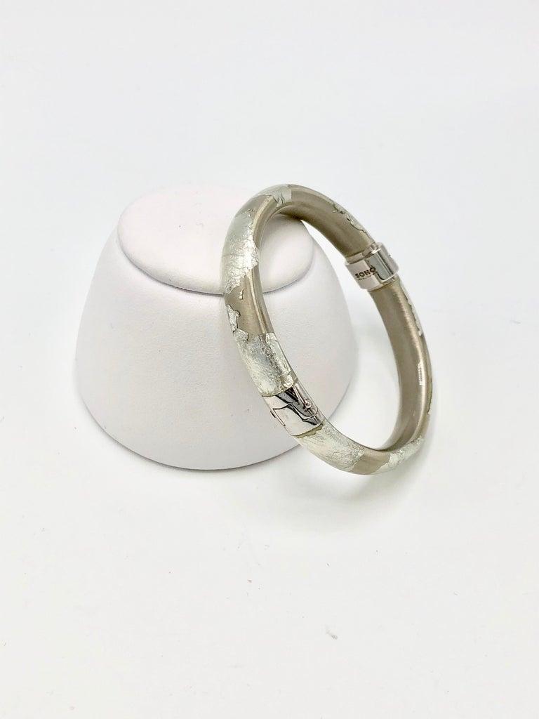 Stylish sterling silver foliage bangle bracelet from SOHO. Designed to be stacked with your favorite SOHO bracelets.