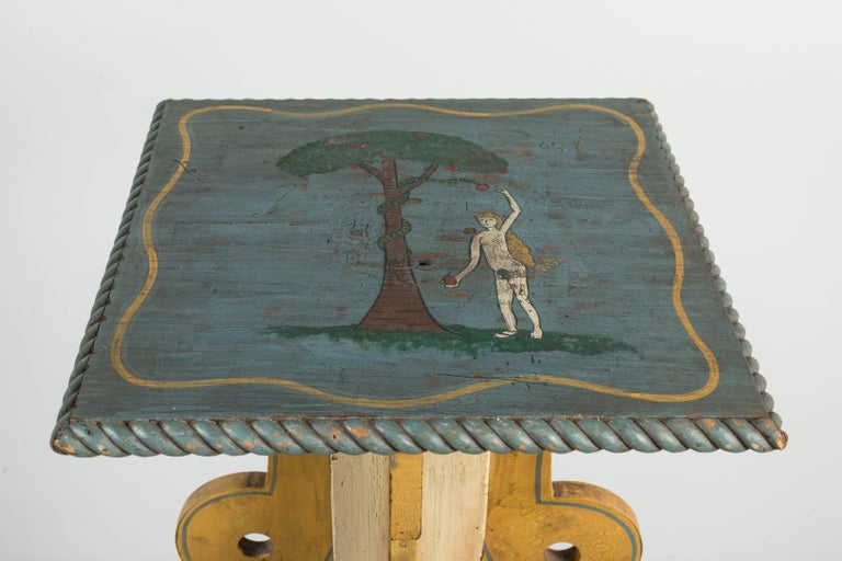 Fantastic hand-painted and carved lodge piece from the Midwest. Painting depicts Eve picking the apple from the snakes mouth. The Stand has a hand-carved snake that wraps around the base. Most likely an Odd Fellows or Masonic Lodge ritual table.