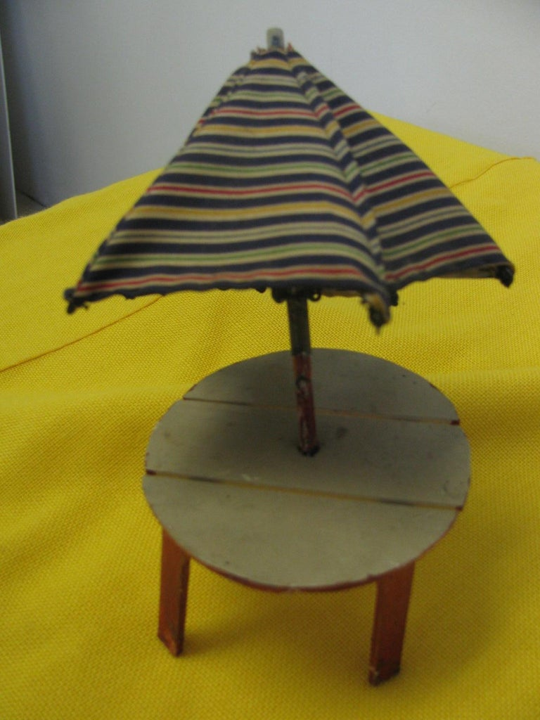 Folk Art Adirondack Chairs With Table And Umbrella For