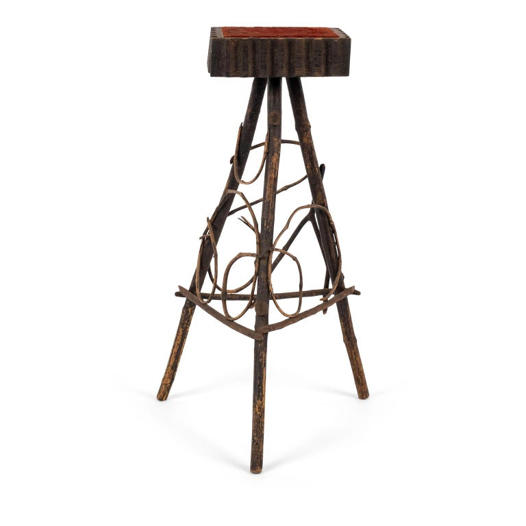 Antique Folk Art twig stand with original red color upholstered top surrounded by hand carved edge.