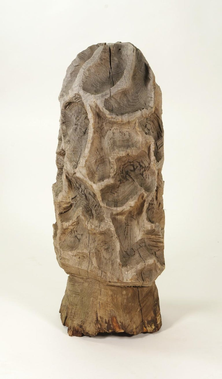 Folk art carved morel mushroom sculpture  The rough, uneven surface of this delightful sculpture suggests it was carved with a chain saw, possibly from a telephone pole.  The base, which has suffered from sitting on the ground, has been filled