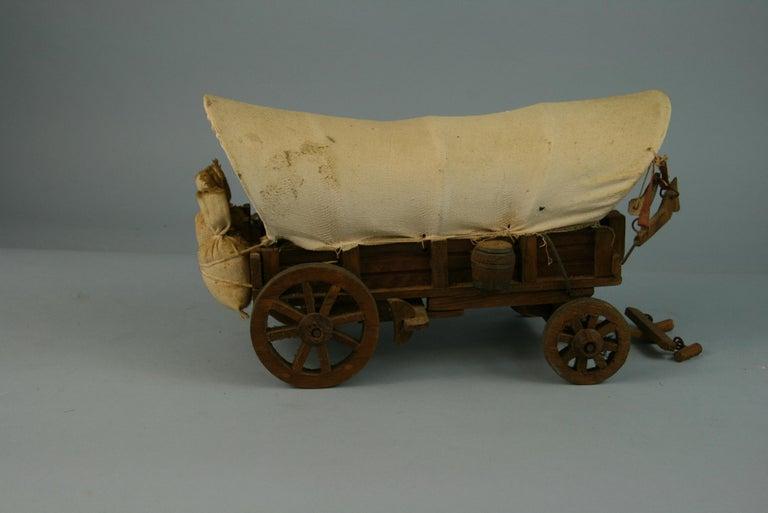 Folk art detailed model of a Conestoga wagon.