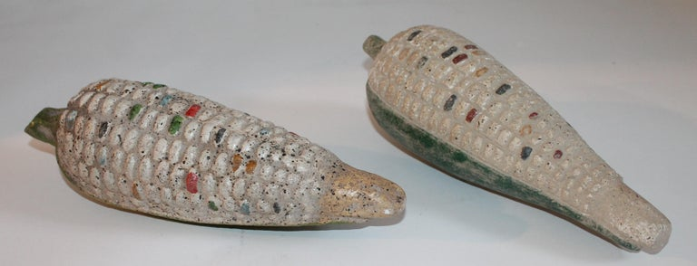 This pair of monumental hand crafted corn are made of terracotta and are from Mexico. The two are in very good condition. They are life-size.