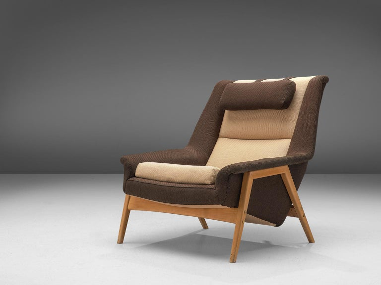 Folke Ohlsson for Fritz Hansen, lounge chair, fabric and wood, Denmark, circa 1960.  This chair by Folke Ohlsson for Fritz Hansen is made to reach an ultimate level of comfort as can clearly be recognized in the design. This Danish chair features