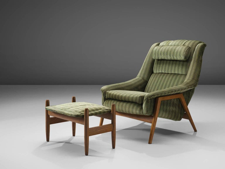 Folke Ohlsson for Fritz Hansen, lounge chair, original green striped velvet, Denmark, circa 1960.  This chair by Folke Ohlsson for Fritz Hansen is made to reach an ultimate level of comfort as can clearly be recognized in the design. This Danish