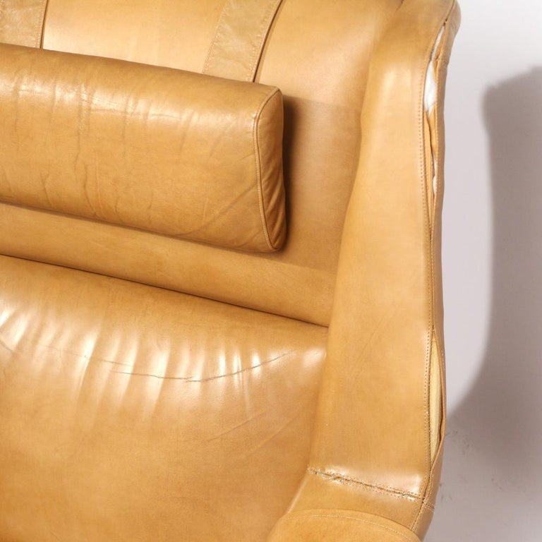 Folke Ohlsson  for DUX , lounge chair and ottoman in cognac brown leather on a teak wood frame with lever-actuated reclining, with matching adjustable ottoman (H 15 x 25 x 18 in.) Measures: H 38, W 33-1/2, D 38 in. (chair).