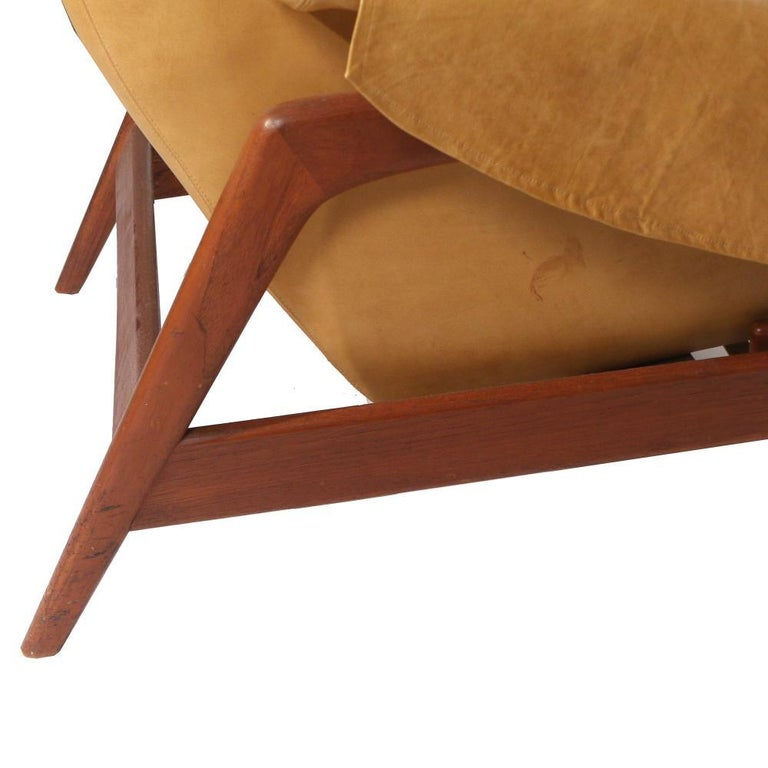 Mid-20th Century Folke Ohlsson Lounge Chair and Ottoman in Leather For Sale
