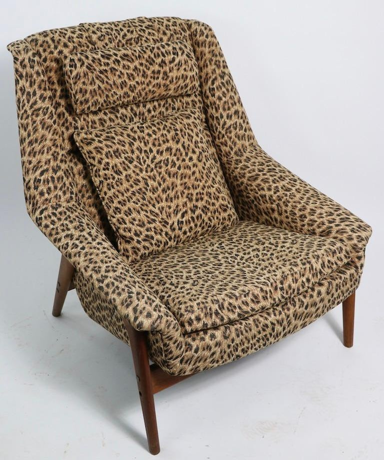 Chic Folke Ohlsson lounge chair in dramatic cheetah print fabric, on exposed teak frame. This example is in very good, clean and original condition. Designed by Folke Ohlsson, for DUX of Sweden, circa 1960s. Please view the companion Folke Ohlsson