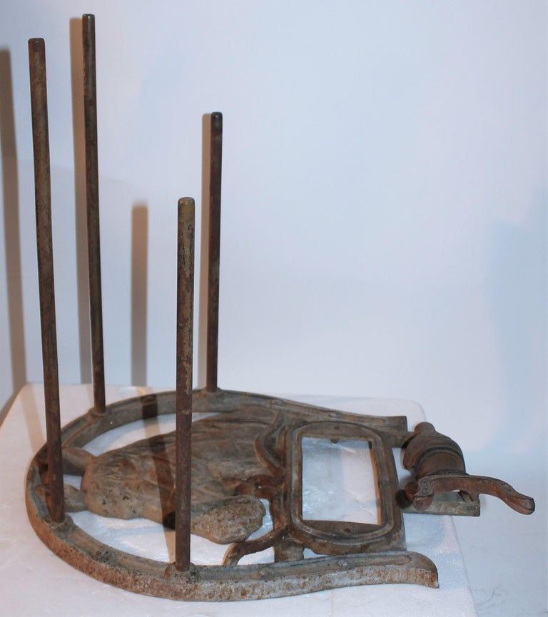 This is a fantastic cast iron boot jack has a horse embossed and pegs for the boots. The condition is very good.