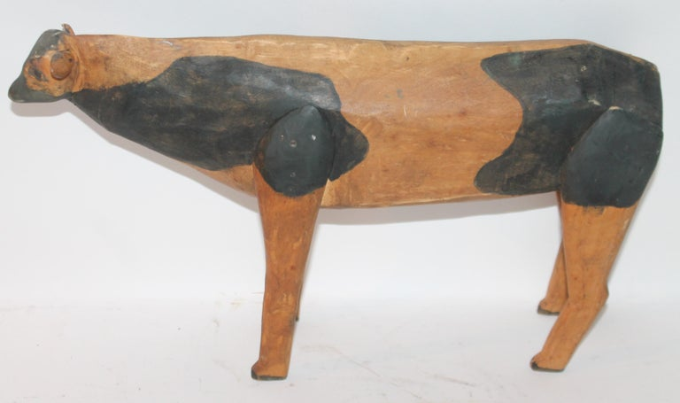 This funky all original paint and hand carved folky cow is in good condition with wear consistent from age and use.