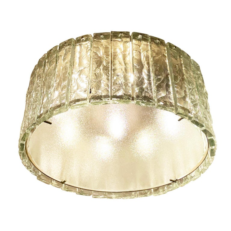 Fontana Arte ceiling light model 2448 designed by Max Ingrand in the 1960s. Features a nickel-plated structure holding dozens of chiseled glasses. Closed at the bottom by a frosted glass diffuser. Holds eight candelabra sockets and one Edison