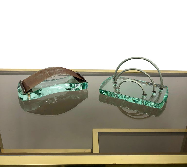 Italian desk set by Fontana Arte, very heavy green nilo glass, made in 1950s, there is a small chip in one of them, as the photos show.   Letter holder dimensions: 10.5cm H x 17.5cm W x 11cm D. Blotter dimensions: 6 cm H x 18cm W x 8 cm D.