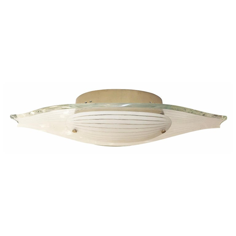 Fontana Arte flush mount model 2340 deigned by Max Ingrand in the 1960's. Composed of a contoured hand polished glass with a frosted glass diffuser at the center. Both glasses have thin etched lines the follow the sloping shape of the fixture.