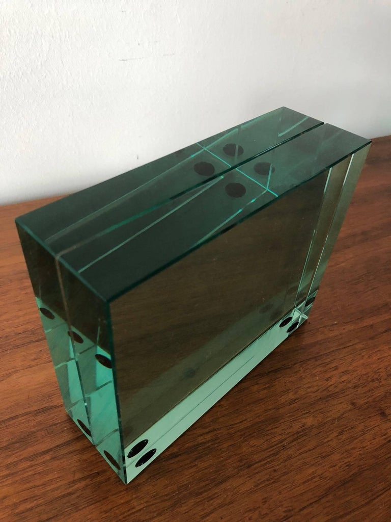 An unusual Fontana Arte minimalist picture frame. Heavy bevelled green glass with opening slot for a pic in between, circa 1980s.