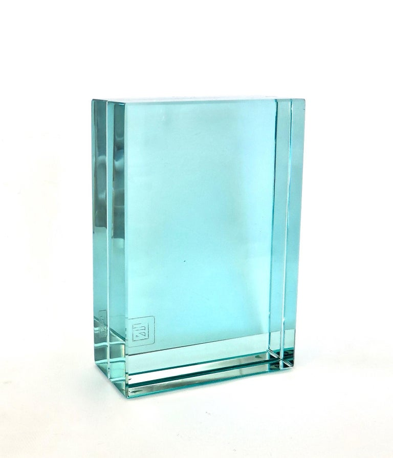 Fontana Arte's Classic Italian Minimalist modern glass picture frame. Heavy beveled green glass with opening slot for one or two photos in the middle. Original label FA in the corner. Small flea bite chip on one corner.