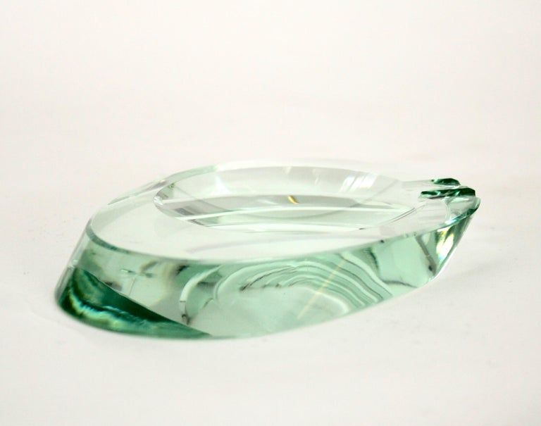 Fontana Arte Murano small glass ashtray dish or vide poche in a very thick optical glass oval form.  The one inch thick edge on this glass ashtray is remarkable and is unique to Fontana Arte Italian glass. One small flea bite chip.