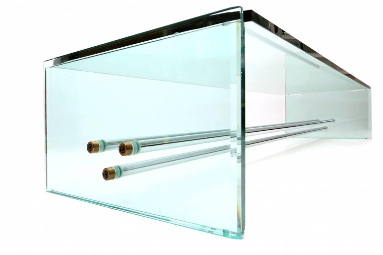 Postmodern rare glass coffee table with chrome tubular design.