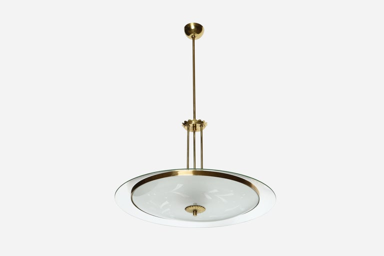 Fontana Arte style chandelier. Made with brass and glass. Italy, 1960s.