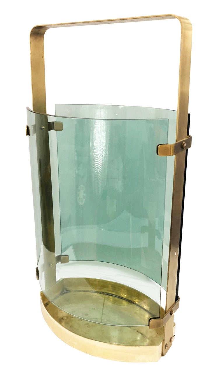 Beautiful 1960s umbrella stand by Fontana Arte with a brass frame and two curved aqua colored glasses.