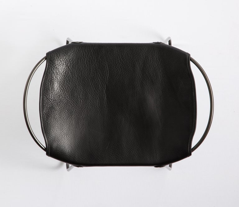 Spanish Footstool, Black Smoke Steel and Black Saddle Leather, HUG COLLECTION.  For Sale
