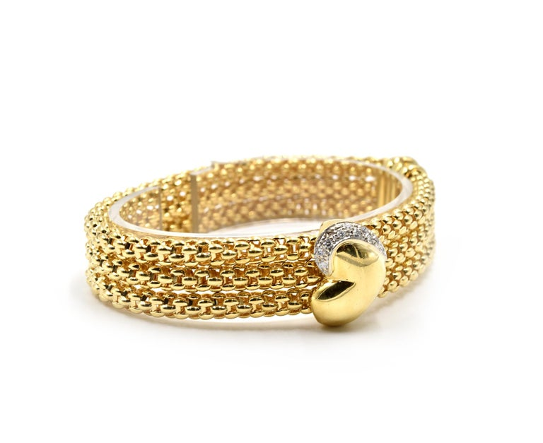 Designer: FOPE Material: 18k yellow gold Diamonds: 11 round brilliant cut diamonds = 0.53 carat total weight Color: G Clarity: VS Dimensions: bracelet is 7 1/2-inch long and 1/2-inch wide Weight: 39.16 grams Retail: $15,800.00