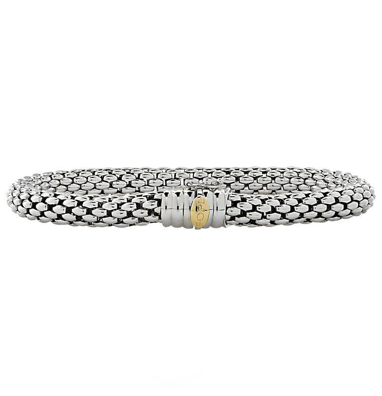 Fope Flex 'it bracelet crafted by hand in Italy in 18 karat white gold with a yellow gold detail. This stunning woven white gold flexible tube bracelet detailed with rondelles glides around the wrist wrapping it in luxury and sophistication