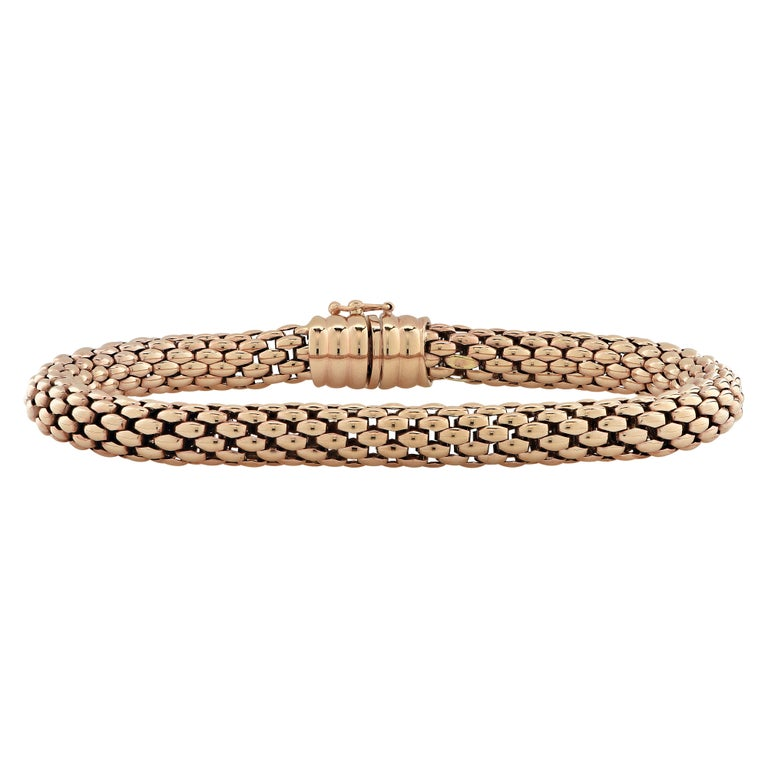 Fope Flex 'it bracelet crafted by hand in Italy in 18 karat rose gold with white gold details. This stunning woven rose gold flexible tube bracelet detailed with rose gold rondelles glides around the wrist wrapping it in luxury and sophistication