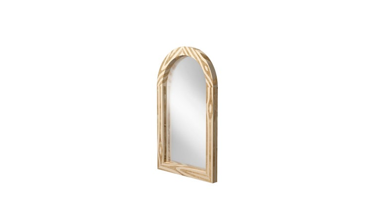 """Forest wall console mirror with brass inlayby Marcantonio, is an arched mirror, and its frame has brass inlay resembling the beauty of natural wood.   For his debut creations, Marcantonio introduced """"Vegetal Animal"""", a concept that evokes strong"""
