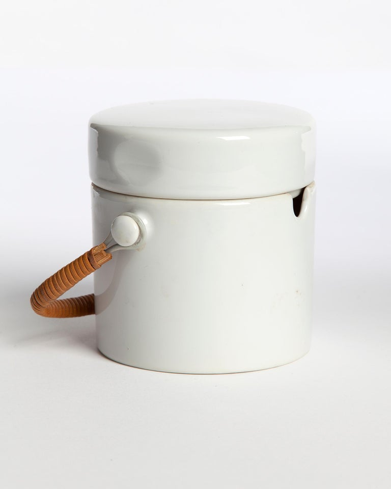 Porcelain sugar bowl with lid and cane handle from the