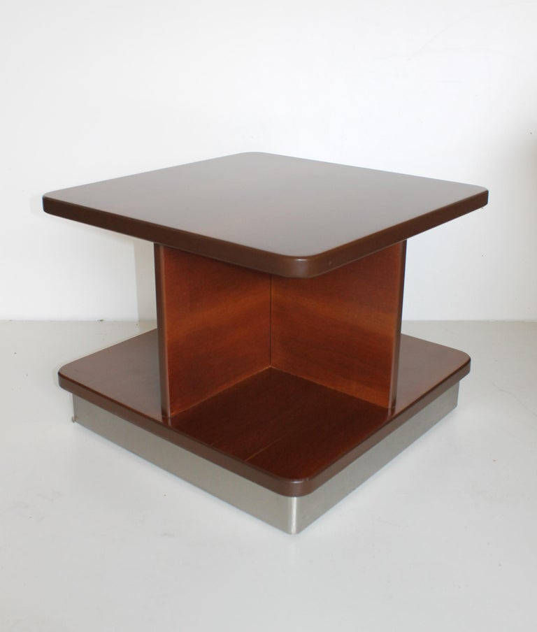 Formanova 1978 rosewood coffee or sofas table with wheels.  Formanova born from the creativity, passion of Gianni Moscatelli. In 1959, after having graduated from the Higher Institute of Design, founded the company, creating a line of products,