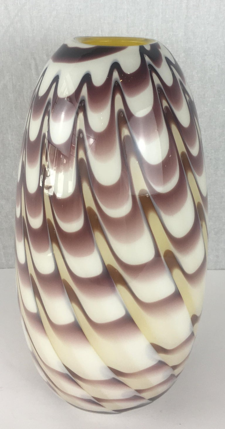Precious vintage art sculpture vase by Formia in overlaid blown crystal clear Murano glass with organic Fenicio decoration in an unusual purple brown color with pale yellow interior. 