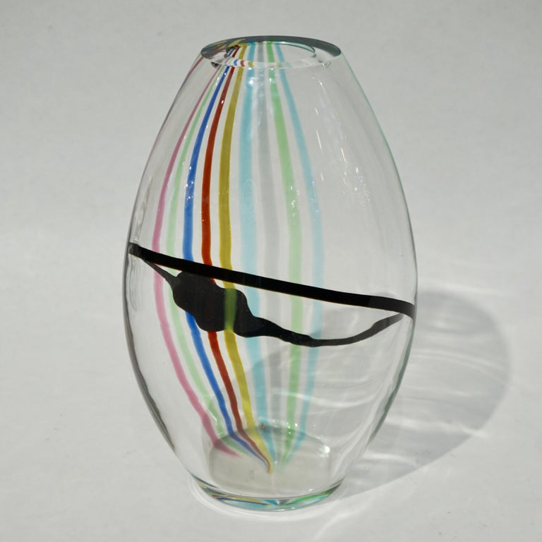 Formia 1970s vintage Italian modern design vase or centrepiece of organic ovoid shape, in blown crystal clear Venetian Murano glass decorated with rainbow stripes in red, aqua blue, pink, apple green, yellow, dark blue, grey and a freeform black