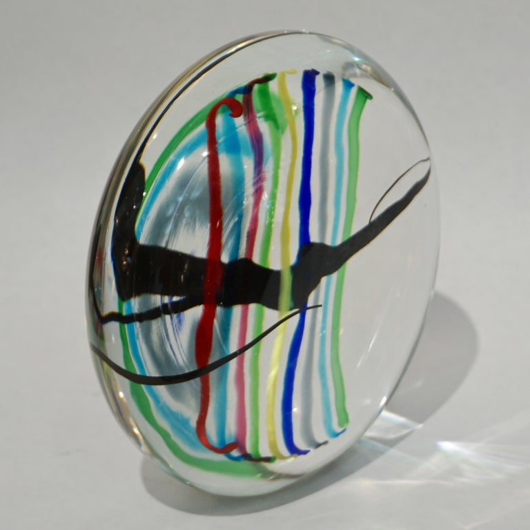 Formia 1970s vintage Italian modern design round sculpture or centerpiece, of organic shape, in blown crystal clear Venetian Murano glass decorated with rainbow stripes in red, aqua blue, pink, apple green, yellow, dark blue, grey and a freeform