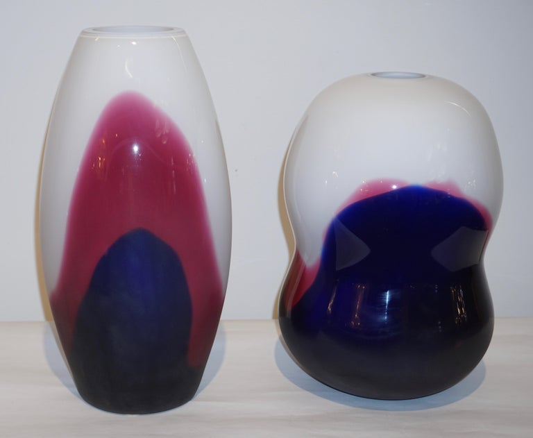 Two vases in blown Murano Art glass signed Formia, created exclusively for Roche Bobois Paris. The very modern minimalist design and execution are striking in the luxurious quality of glass, that resembles enamel, multi layers of glass on ivory