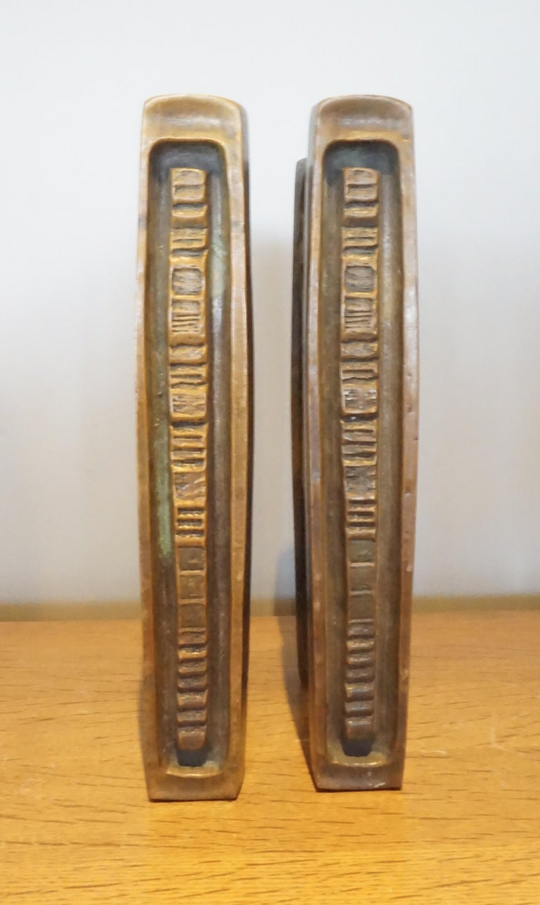 A pair of two-sided Mid-Century Modern solid bronze door handles made by the American hardware company Forms and Surfaces in the 1960s. These cast bronze pulls were created for double entry doors and are over-sized, extremely heavy and of superior