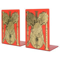 Fornasetti Bookends Strumenti Musicali Gold on Red Metal