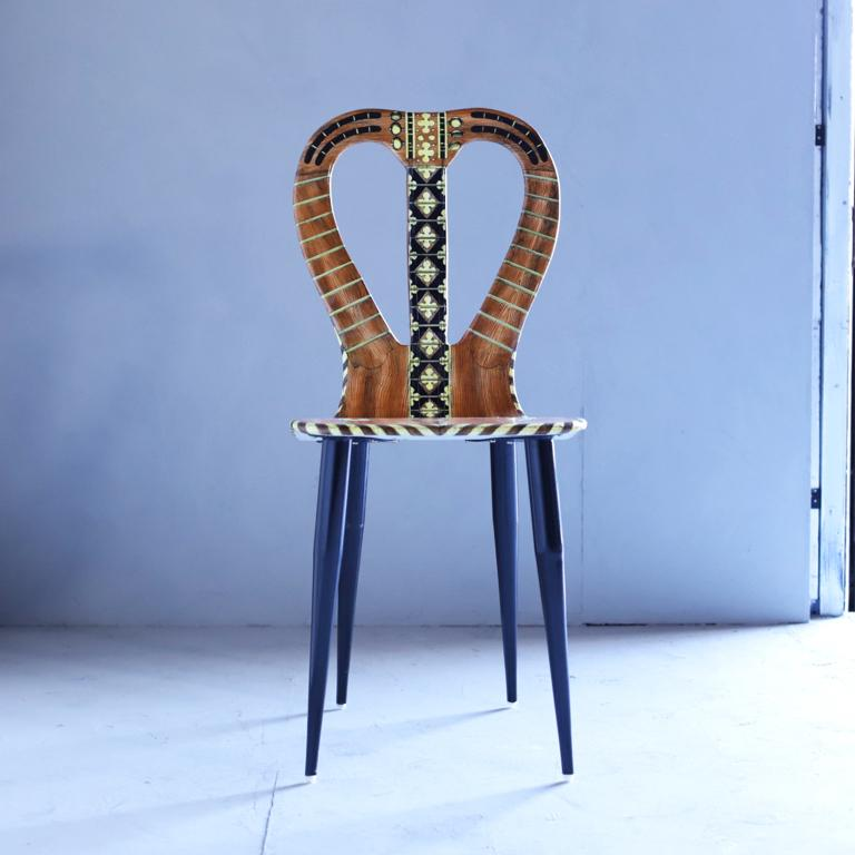 """A """"Musicale"""" chair by Atelier Fornasetti. Lithographically printed. Hand colored wood, lacquer, metal tubular legs."""