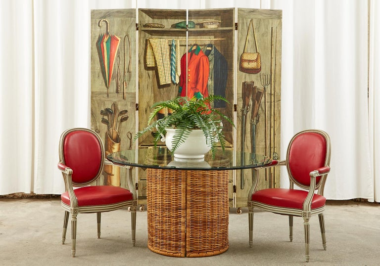 Iconic and rare Piero Fornasetti four panel screen made in Milano, Italy. Mid-century modern lithograph transfer print on painted wooden panels. Titled Armadio Aperto or open cabinet and features a trompe l'oeil depiction of a wooden closet stuffed