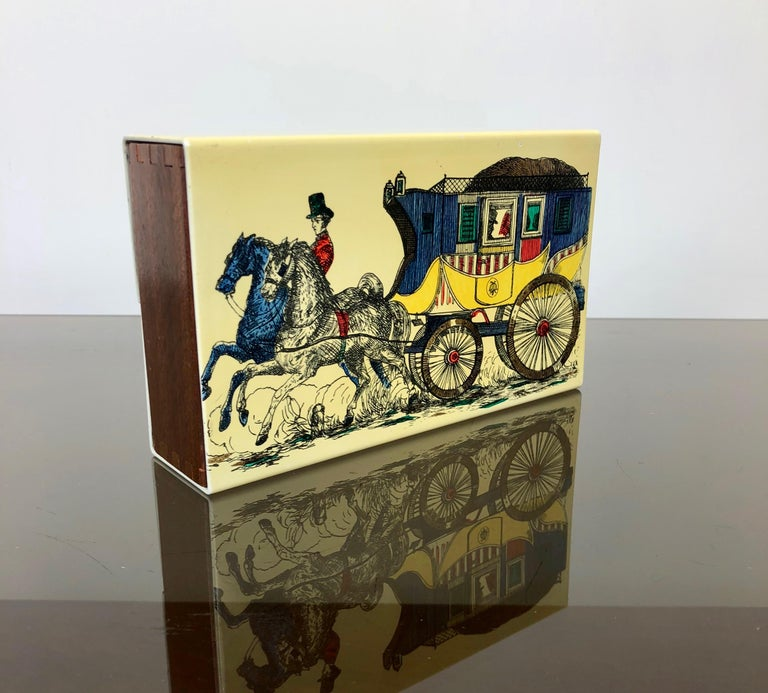 Italian Mid-Century modern card box by Fornasetti in metal wood, representing a carriage with coachmen pulled by two horses.   This typo of artistic boxes was created to stay over time as cigarette cases, jewelry boxes, etc.