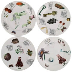 Fornasetti, Milano, Four Plates in Hand-Painted Porcelain, 1980s