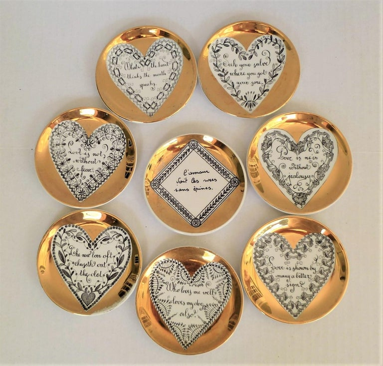 Perfect gift for the lover in all of us, 8 decorated love coasters, all by Piero Fornasetti and one by Bucciarelli, 1950s. Featuring English love themed messages in hearts the centers, they all have gilt backgrounds. The Buccirelli in a diamond in