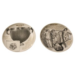 Fornasetti, White Porcelain Black and Gold Printed Round Plates, Italy, 1970s